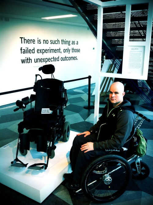Mark with Christopher Reeve's chair at FAIL BETTER exhibition